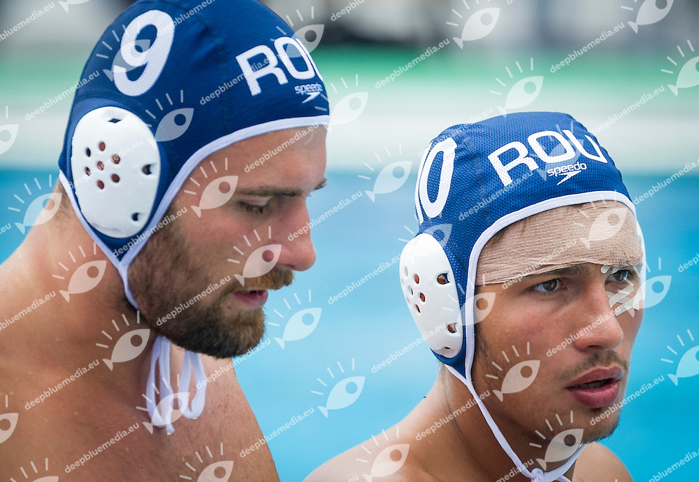 9 GOANTA Dimitri ROU<br /> 10 GHEORGHE Minnea ROU<br /> Spain (White) Vs Romania (Blue) Men<br /> LEN European Water Polo Championships 2014 - July 14-27<br /> Alfred Hajos -Tamas Szechy Swimming Complex<br /> Margitsziget - Margaret Island<br /> Day13 - July 26<br /> Photo Giorgio Scala/Inside/Deepbluemedia