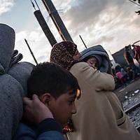 A family is seen arrivng walking on the rail road trak at the Greek Macedonian border not far from the Greek village of Idomeni, Greece. FEDERICO SCOPPA/CAPTA