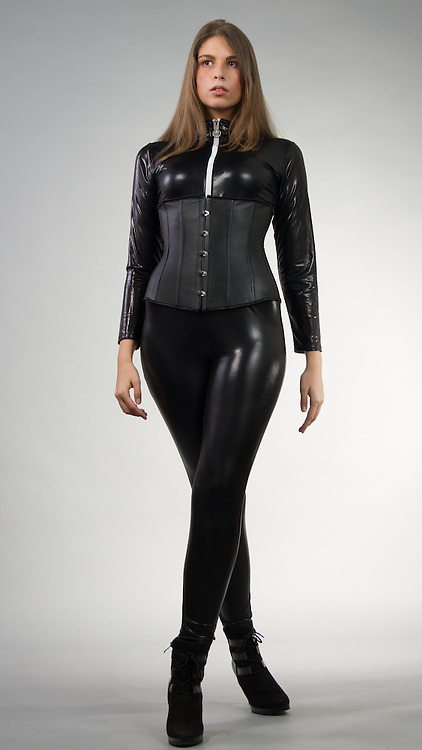 Female model posing in a catsuit and a corset.