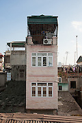 Pink Tube House seen from Long Bien Bridge Hanoi, Vietnam