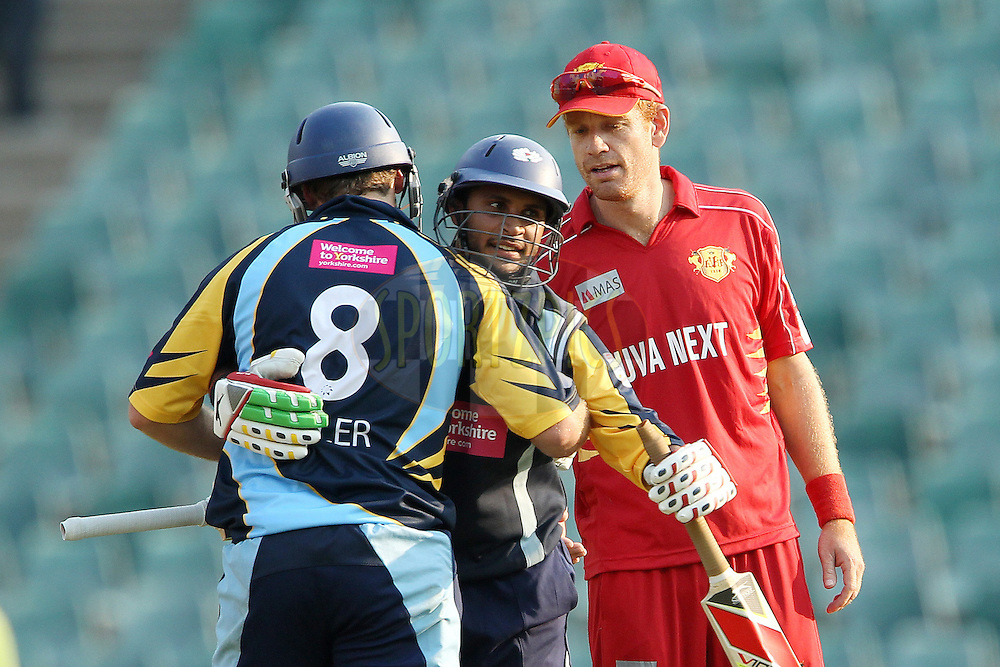David Miller and Adil Rashid celebrate the win for Yorkshire during 1st Qualifying match of the Karbonn Smart CLT20 South Africa between Uva Next and Yorkshire held at The Wanderers Stadium in Johannesburg, South Africa on the 9th October 2012..Photo by Ron Gaunt/SPORTZPICS/CLT20