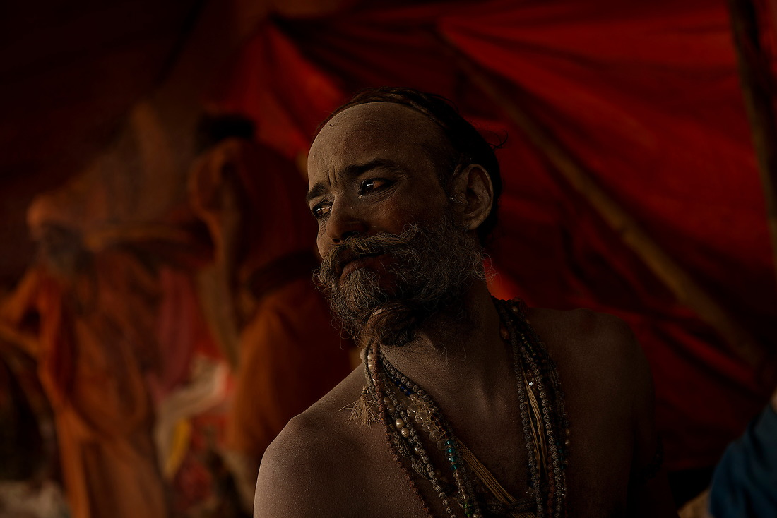 A Sadhu (holy man) sits in his camp on February 5, 2013 in Allahabad, India during the Kumbh Mela.   A Sadhu is an ascetic holy man who renounce worldly pleasures in pursuit of higher values of life in order to attain enlightenment. Through strict and hard practice Sadhu detached themselves from  pleasures and pains of human life which makes them indifferent from world and transports them to the metaphysical world. — © Jeremy Lock/