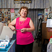 Angeliki Ioanniti 65,  a dressmaker user of TEM ( local alternative currency  of Volos) in her workshop that also serves as the secretariat of TEM network