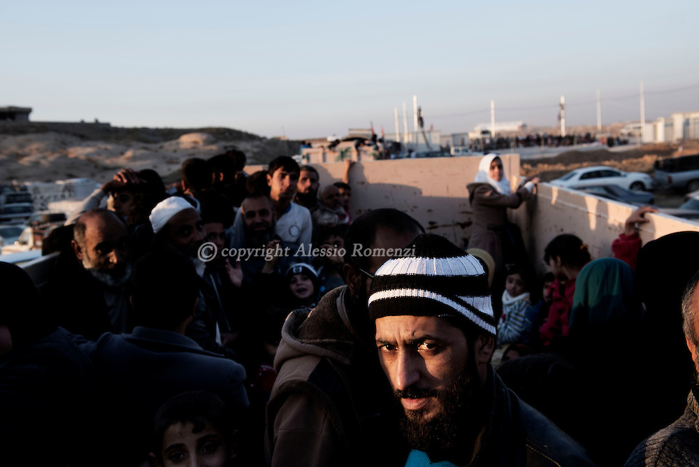 Iraq: Civilians arrive by truck at the entrance of the Hasan Sham IDP camp in Al Kazir area after fleeing fighting in Mosul on November 5, 2016. Alessio Romenzi