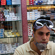 Christos Matsoukas  wearing protective googles and mask working in his grocery shop in Apollonos 6 near Syntagma (Constitution) square, during the protests in Athens against the  unpopular austerity measures, June 29, 2011