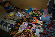 Palestinian children who fled with their families from Khan Eshieh refugee camp, near Damascus , sleep on the floor of a house in Jalil Palestinian refugee camp, in Baalbek, Lebanon. The two-room house is home to five Palestinian families, 30 people, who fled Syria because of the civil war. Currently there 60,000 Palestinian-Syrian refugees in Lebanon, with many of those staying with friends and relatives in the Lebanese camps.