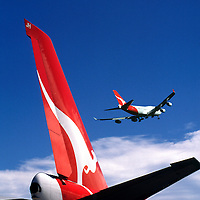 Qantas tailplane with plane passing.<br />