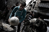 SYRIA, ALEPPO. A rebel fighter hold a hand made bomb in the old part of Syria's northern city of Aleppo. ALESSIO ROMENZI