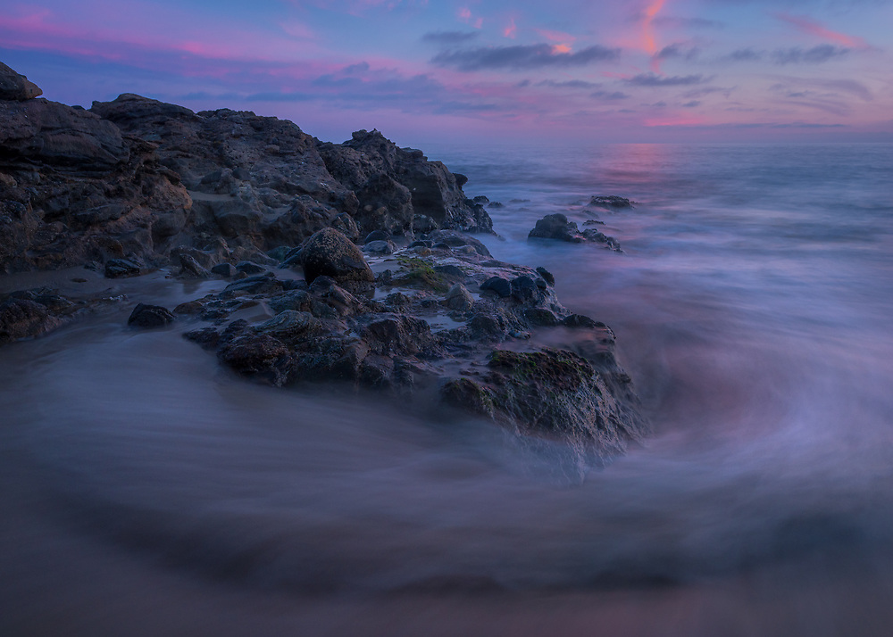 I love capturing abstraction at the beach and this particular evening in Laguna Beach was no different. Having created images at the beach that depict the raw energy of the sea, I want to have a calmer composition: the soothing power of the sea. This is one of those images.