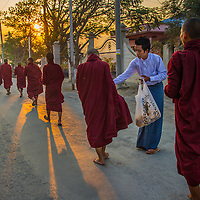 Monks receiving food at Taung Gyi Village in Myanma
