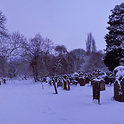Panorama of Nottingham cemetery in February snow taken at midnight.