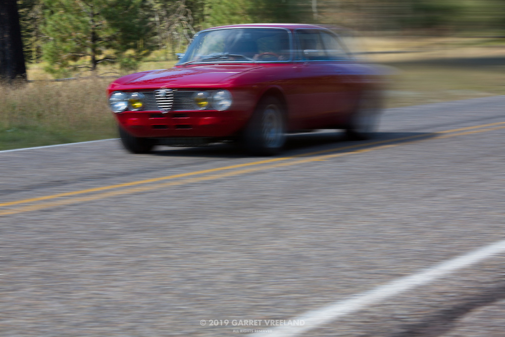 The 1973 Alfa Romeo GTV zooms past, on the 2012 Santa Fe Concorso High Mountain Tour.<br />