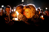 Two women hug outside of Saint Rose of Lima Catholic Church in Newtown, Connecticut during a prayer service and vigil in response to a shooting that left at least 26 people dead including 18 children at the Sandy Hook School earlier in the day on December 14, 2012.  A gunman opened fire inside inside Sandy Hook Elementary School early Friday morning where his mother worked.  The suspect 20-year-old Adam Lanza, reportedly killed himself following the shooting rampage inside the school.  This is the worst school shooting in the country's history.  UPI/Matthew Healey