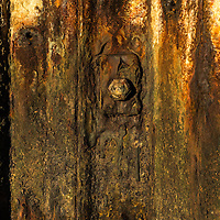 Detail of a rusty metal seawall.