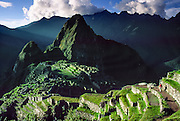"""Machu Picchu is a magnificent Inca archeological site in the Cordillera Vilcabamba, Andes mountains, Peru, South America. Machu Picchu was built around 1450 AD as an estate for the Inca emperor Pachacuti (14381472). Spaniards passed in the river valley below but never discovered Machu Picchu during their conquest of the Incas 1532-1572. The outside world was unaware of the """"Lost City of the Incas"""" until revealed by American historian Hiram Bingham in 1911. Machu Picchu perches at 2430 meters elevation (7970 feet) on a well defended ridge 450 meters (1480 ft) above a loop of the Urubamba/Vilcanota River (Sacred Valley of the Incas). UNESCO honored the Historic Sanctuary of Machu Picchu on the World Heritage List in 1983."""