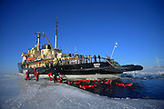 Swimming in the frozen sea during Sampo Icebreaker cruise, an authentic Finnish icebreaker turned into touristic attraction in Kemi, Lapland