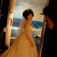 A woman is waiting to have her wedding pictures taken at New-York, New-York Studios in central Beijing. September 2005.                                .