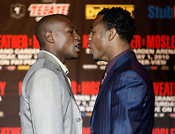 Mar 2, 2010; New York, NY, USA; Floyd Mayweather (l) and Shane Mosley (r) push and shove during the press conference announcing their May 1, 2010 fight.  The two fighters will meet at the MGM Grand Garden Arena.