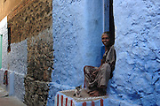 Woman at doorway to her home. at Kottar, Nagarcoil. Tamil Nadu.