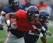 Ole Miss's Randall Mackey (1) is tackled by Anthony Standifer (23) at football practice at Vaught-Hemingway Stadium in Oxford, Miss. on Saturday, August 18, 2012.