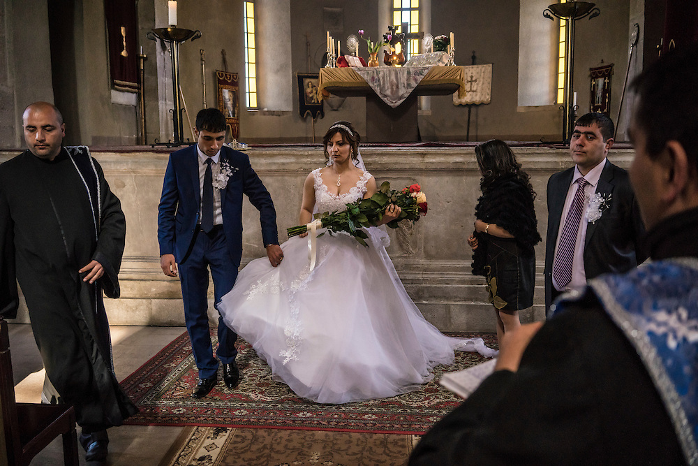SHUSHI, NAGORNO-KARABAKH - APRIL 18: Groom Davit Simonyan, 24, and bride Shogher Hovsepyan, 25, hold their wedding at Ghazanchetsots church on April 18, 2015 in Shushi, Nagorno-Karabakh. Since signing a ceasefire in a war with Azerbaijan in 1994, Nagorno-Karabakh, officially part of Azerbaijan, has functioned as a self-declared independent republic and de facto part of Armenia, with hostilities along the line of contact between Nagorno-Karabakh and Azerbaijan occasionally flaring up and causing casualties. (Photo by Brendan Hoffman/Getty Images) *** Local Caption *** Davit Simonyan;Shogher Hovsepyan