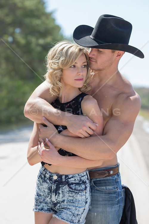 cowboy together outdoors being affectionate muscular shirtless cowboy