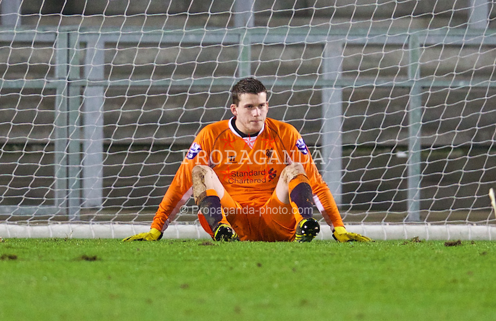 ST. HELENS, ENGLAND - Wednesday, January 15, 2014: Liverpool's goalkeeper Ryan Crump looks dejected after conceding a goal to Aston Villa during the FA Youth Cup 4th Round match at Langtree Park. (Pic by David Rawcliffe/Propaganda)