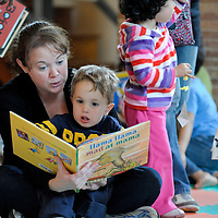 A mother reads to her son at the children's activity area during the Boston Book Festival at the Boston Public Library.