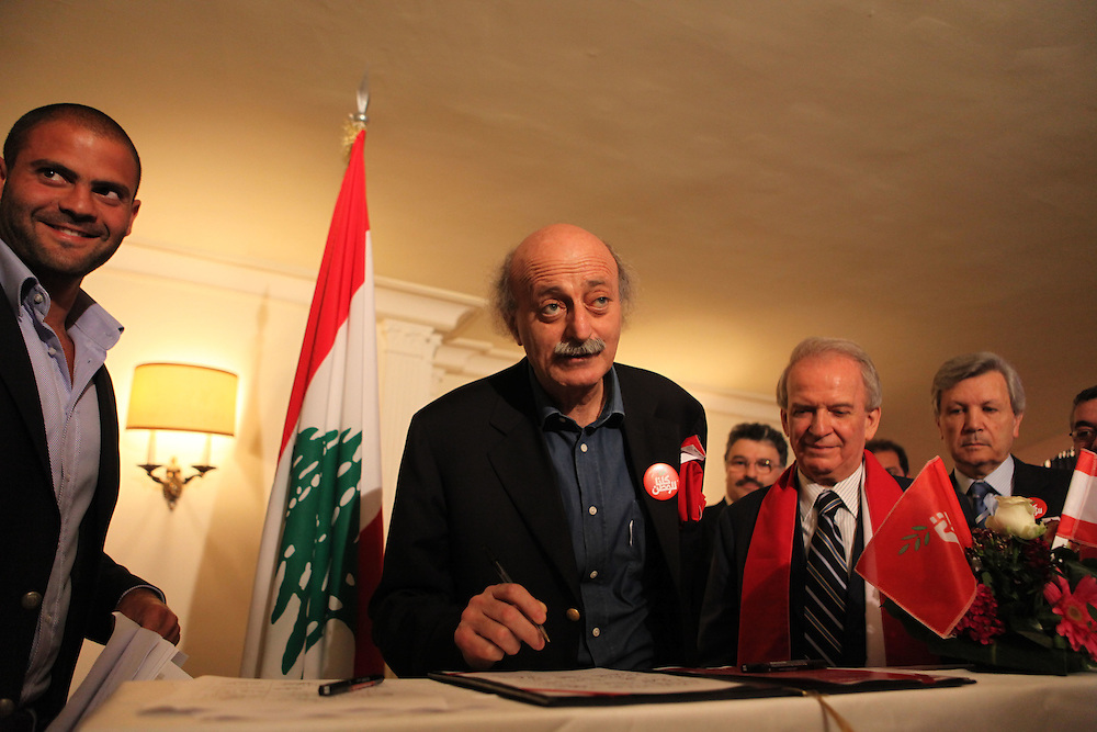 Less than two weeks before Lebanese go to the polls to elect a new parliament, leaders of the various parties that make up the governing March 14 coalition met in Beirut's Bristol Hotel to reaffirm their partnership. The meeting was attended by dozens of political leaders including Sunni Muslim leader of the Future Movement, Saad Hariri, and Druze leader, Walid Jumblatt. The upcoming parliamentary elections are important in that they put the pro-Western March 14 alliance against the Hizballah-led March 8 alliance. Saad Hariri said earlier in the day, that he refuses to join any coalition with the resistance and political group, who is supported by Iran and Syria. ///Walid Jumblatt, leader of the Druze community and the Progressive Socialist Party signs the March 14 unity statement at the end of the coalition's meeting.