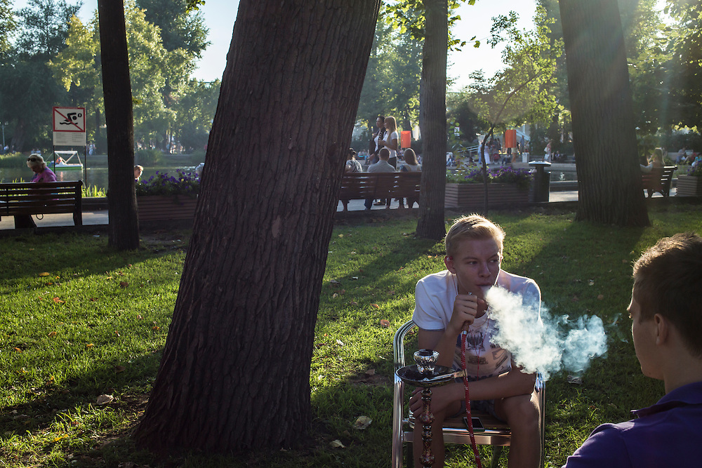 Alex Rychkov and Stepan Danilenko share a hookah in Gorky Park on Saturday, August 17, 2013 in Moscow, Russia.