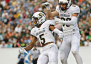 SHOT 9/19/15 6:28:11 PM - Colorado's Shay Fields #5 celebrates a touchdown catch with teammate Dylan Keeney #86 during the Rocky Mountain Showdown against Colorado State at Sports Authority Field at Mile High in Denver, Co. Colorado won the game 27-24 in overtime. (Photo by Marc Piscotty / © 2015)