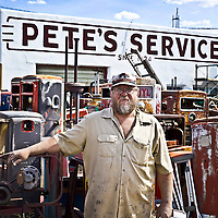 Randy Kimball of Pete's Service in Pine Bluffs, Wyoming. Kimball works at Pete's Service, which is on the Lincoln Highway near the Wyoming/Nebraska Border. The shop has dozens of vintage gas pumps. <br /> <br /> /// ADDITIONAL INFORMATION: 5/24/11 - travel.Lincoln.East.0929.sp - STUART PALLEY Lincoln Highway West