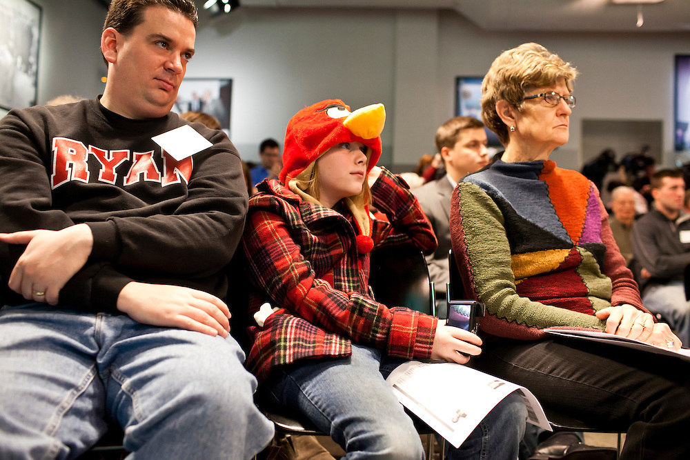"Jim Meredith and his daughter, Mary Grace Meredith, 10, from Philadelphia, and Marilyn Paradis of Toledo, Ohio, from left, listen as Republican presidential candidate Rick Santorum participates in ""The Electorate and the Economy"" forum at St. Anselm College on Saturday, January 7, 2012 in Manchester, NH. Brendan Hoffman for the New York Times"