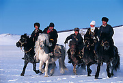 Tsaatan youths returning home<br /> Nomadic tribe with +-200 individuals left who still live in teepees<br /> Taiga Forest<br /> Northern Mongolia