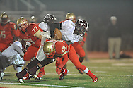 Lafayette High's Kewuan Owens (43) makes a tackle vs. Greenwood in MHSAA Class 4A playoff action in Oxford, Miss. on Friday, November 15, 2013. Lafayette won 7-0.