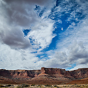 SHOT 10/17/16 10:38:26 AM - White Rim mountain biking trip in Canyonlands National Park just outside of Moab, Utah. The White Rim Road is a 71.2-mile-long unpaved four-wheel drive road that traverses the top of the White Rim Sandstone formation below the Island in the Sky mesa of Canyonlands National Park in southern Utah in the United States. The road was constructed in the 1950s by the Atomic Energy Commission to provide access for individual prospectors intent on mining uranium deposits for use in nuclear weapons production during the Cold War. Four-wheel drive vehicles and mountain bikes are the most common modes of transport though horseback riding and hiking are also permitted.<br /> (Photo by Marc Piscotty / &copy; 2016)