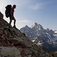 WY00630-00...WYOMING - Backpacker above Lake Solitude near Paintbrush Divide in Grand Teton National Park.