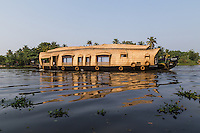 "The main mode of transportation in Kerala Backwaters has always been by kettuvalloms which means ""roof boat"". They are usually made with wood joined  together with coconut ropes and painted with cashew oil outside. Many kettuvalloms have been converted to houseboats with  beds, kitchens and toilets."