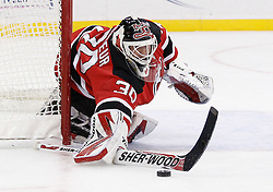 Oct 17, 2009; Newark, NJ, USA; New Jersey Devils goalie Martin Brodeur (30) blocks a pass during the third period at the Prudential Center. The Devils defeated the Hurricanes 2-0.
