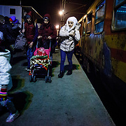 Refugees arrive off of the train from Gevgelija (the Macedonia-Greece border). Tabanovce is the transit stop before they cross the border into Serbia on their way into Western Europe in search of a peaceful life.  There is no train schedule-the trains leave Gevgelija when they fill up, therefore over the winter two to three trains a day have been arriving in Tabanovce at varying times of day and night. Macedonia, January 2016.