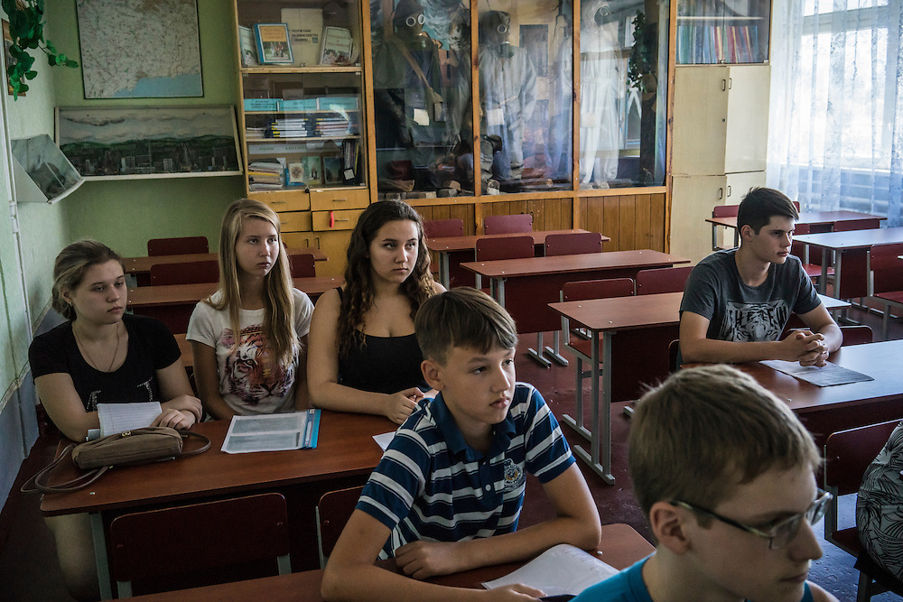 MARIUPOL, UKRAINE - AUGUST 31, 2015: Students rehearse presentations which they will make on the first day of school at School 68 in Mariupol, Ukraine. A recent decrease in fighting has been credited to a desire to not interfere with the start of a new school year, planned for September 1. CREDIT: Brendan Hoffman for The New York Times