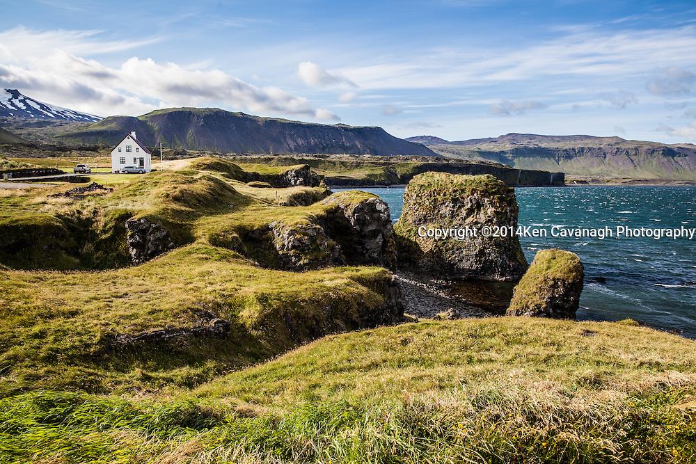 White house in hamlet of Arnastapi on Snaefellsness Peninsula.