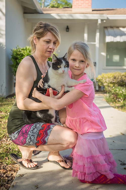"Jonnika Benjamin with her daughter, Abby, and their cat, Lily, in front of their home in Calistoga.  ""We moved here two years ago from Santa Rosa so my husband could be closer to his plumbing job."""