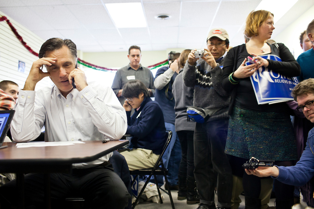 Republican presidential candidate Mitt Romney calls potential supporters during a visit to his New Hampshire campaign headquarters on Monday, January 9, 2012 in Manchester, NH. Brendan Hoffman for the New York Times