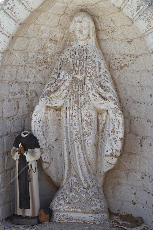 decaying statues in a cemetery in New Mexico