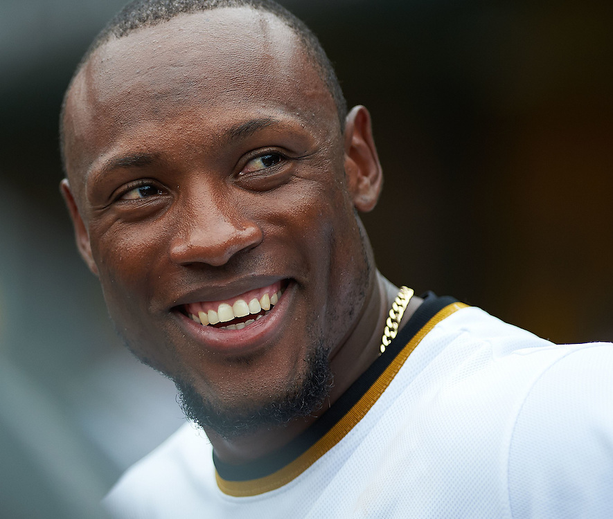 Pittsburgh Pirates left fielder Starling Marte (#6) smiles at fans after the game against the Cincinnati Reds at PNC Park in Pittsburgh on August 30, 2014.  © 2014 Shelley Lipton.
