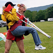 Dan Brendan, 57, from Phoenix, AZ, picks up his wife to carry her across the finish line after completing the Massanutten Mountain Trails 100 Mile run (MMT 100) May 17, 2008..Brendan finished 34th overall with a time of 30:17:39. .The  MMT 100 is considered one of the toughest Ultra Marathons on the east coast. The  Massanutten Mountain Trails 100 Mile run (MMT 100) May 17, 2008.<br /> The  race is considered one of the toughest Ultra Marathons on the east coast.