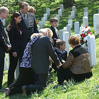 CAPTION: (Washington, D.C. 4/5/2005) Family and friends gather beside the headstone for her husband, Medal of Honor recipient Sgt. 1st Class Paul Smith, following its unveiling during a ceremony at Arlington National Cemetery in Washington, D.C. Tuesday (4/5/05). Closest to the headstone is his wife Birgit Smith (cq) and son, David Smith (facing headstone).  At right, is Olivia Rae DeVane, 3.