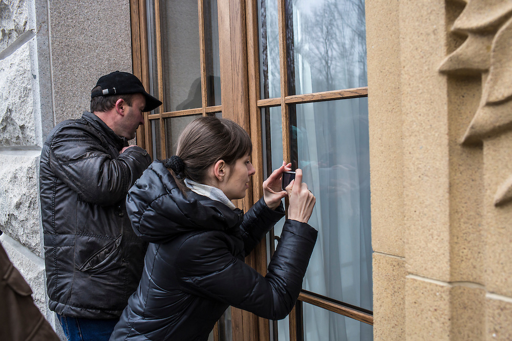 KIEV, UKRAINE - FEBRUARY 22: People photograph through the windows of President Viktor Yanukovych's Mezhyhirya estate, which was abandoned by security, on February 22, 2014 in Kiev, Ukraine. After a chaotic and violent week, protesters took control of Kiev as President Viktor Yanukovych fled the city amid calls for his immediate resignation. (Photo by Brendan Hoffman/Getty Images) *** Local Caption ***