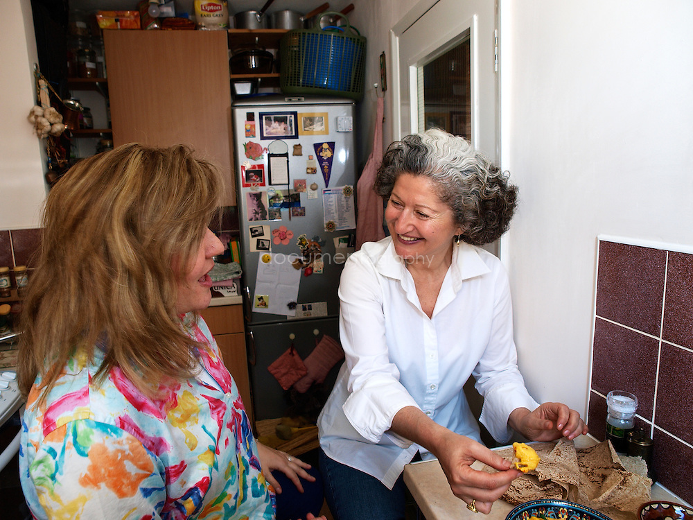 Lebanese Chef Anissa Helou and Palestinian singer Reem Kelani in Reem's kitchen in London, eating the Palestinian meal that they prepared together .